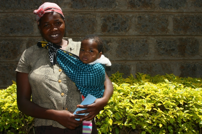 A woman and her child outside Lea Toto in Kangemi, Kenya. Picture: Carolilne Kaminju